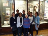 Delegation from Tagai State College in front of the Torres Strait  display at the MAA. (l-r) Curator Anita Herle, Stephen Yamashia, Amelie  Mari, Valent Kirk, Margaret Rishbeth (Haddon's granddaughter) Zach Bani,  Tanisha Pabai and Deb Belyea.
