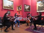 Purcell quartet performing in front of Stubbs