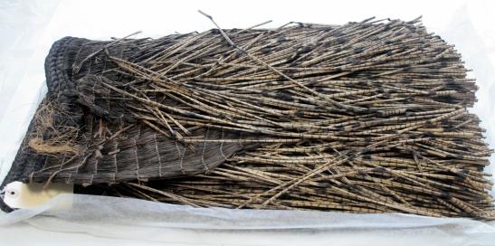 A folded, unsupported Māori rain-cloak