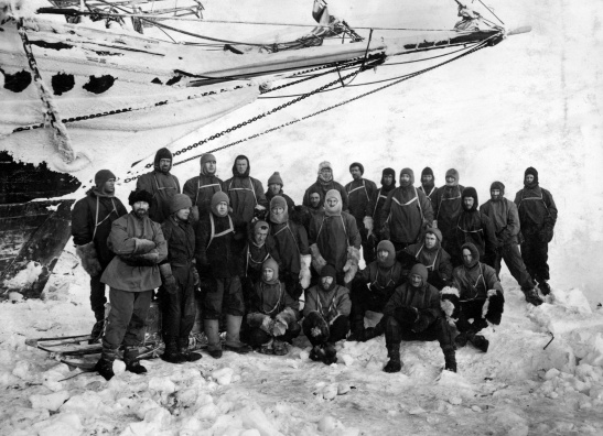 Shackleton and his men at the bow of 'Endurance' in the austral Spring of 1915. SPRI Picture Library P/66/19/146