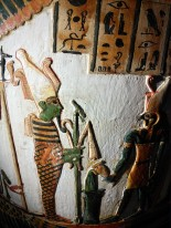 8. E.64.1986 detail showing the original colours on the figures decorating the coffin of Nakhtefmut