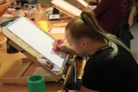 Lizzie working in the Fitzwilliam Museum Studio on her Baby's portrait using Acrylics on Canvas boards